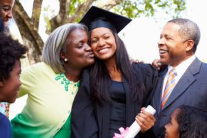 a family congratulating their child at their college graduation