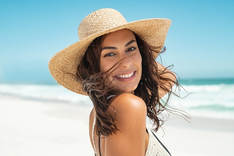 Woman smiling while enjoying vacation on the beach